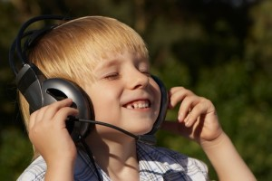 bigstock-Relaxed-little-boy-listening-25973171